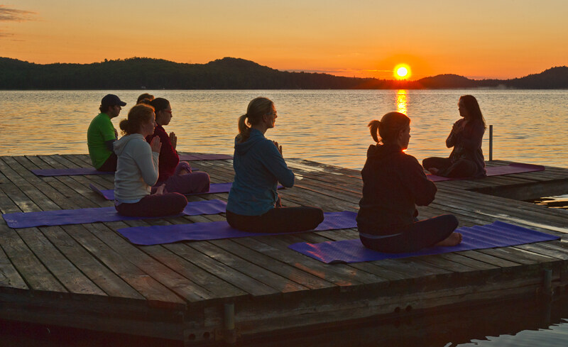 Yoga on dock in Northern Ontario