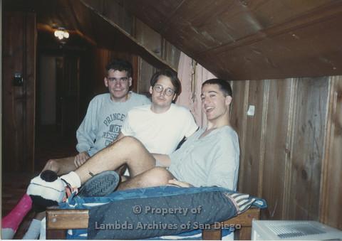 P001.186m.r.t Retreat 1991: 3 men sitting on a bed
