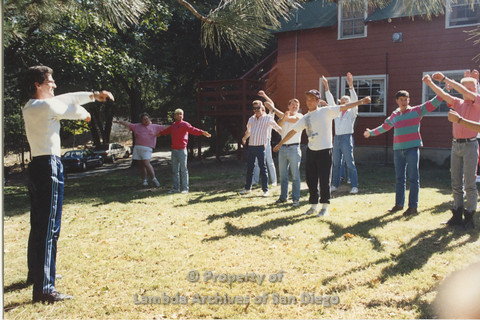 P001.192m.r.t Retreat 1991: group of people stretching (from the front)