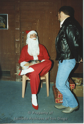 P001.268m.r.t  X-mas: Santa Claus and man in leather jacket