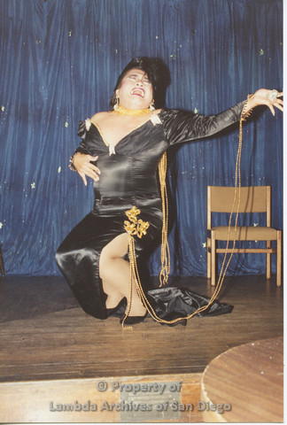 P001.244m.r.t Through The Years Fundraiser: drag queen wearing a black dress