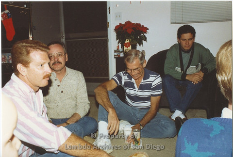 P001.027m.r X-mas 1990: Group of men, 3 men sitting on the ground