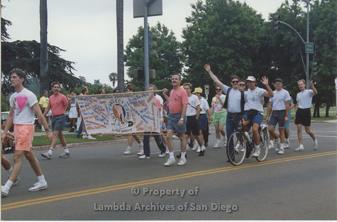 P001.032m.r Pride 1991: Group of men holding banner (Project Life Guard)