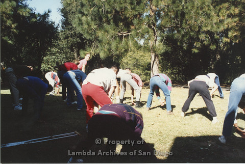 P001.189m.r.t Retreat 1991: group of people stretching (from the back)
