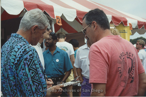 P001.060m.r  Pride 1991: people standing in front of the AIDS Foundation San Diego booth