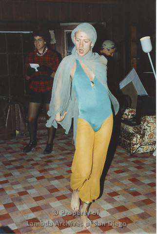 P001.231m.r.t Retreat 1991: man dressed in drag wearing a blue unitard and gold pants