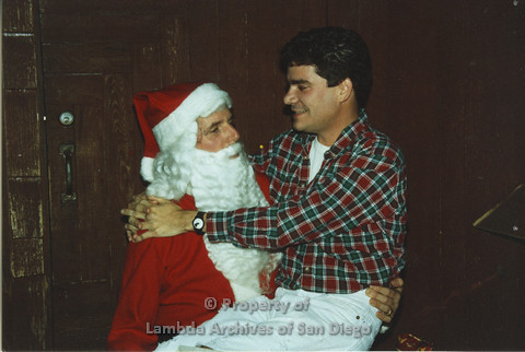 P001.299m.r.t X-mas: man in red and green plaid shirt sitting on Santa's lap