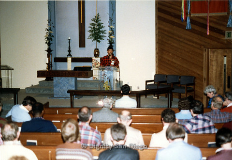 P103.040m.r.t Dignity San Diego: Henry speaking in front of church congregation
