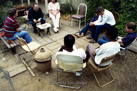 P103.076m.r.t Dignity San Diego: Men and women in yard sitting in a circle