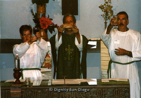 P103.049m.r.t Dignity San Diego: Church leader and altar people, Earl on right, holding communion