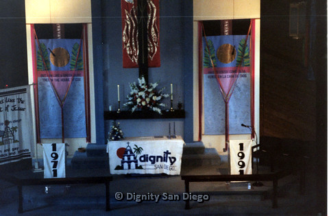 "P103.141m.r.t High view of Dignity San Diego church alter with banners reading ""1971"" and ""1991"""