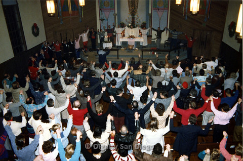 P103.021m.r.t Dignity San Diego, Christmas Eve Mass 1988: Whole church congregation holding hands raised