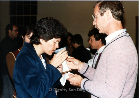 P103.003m.r.t Dignity San Diego:  Woman taking communion