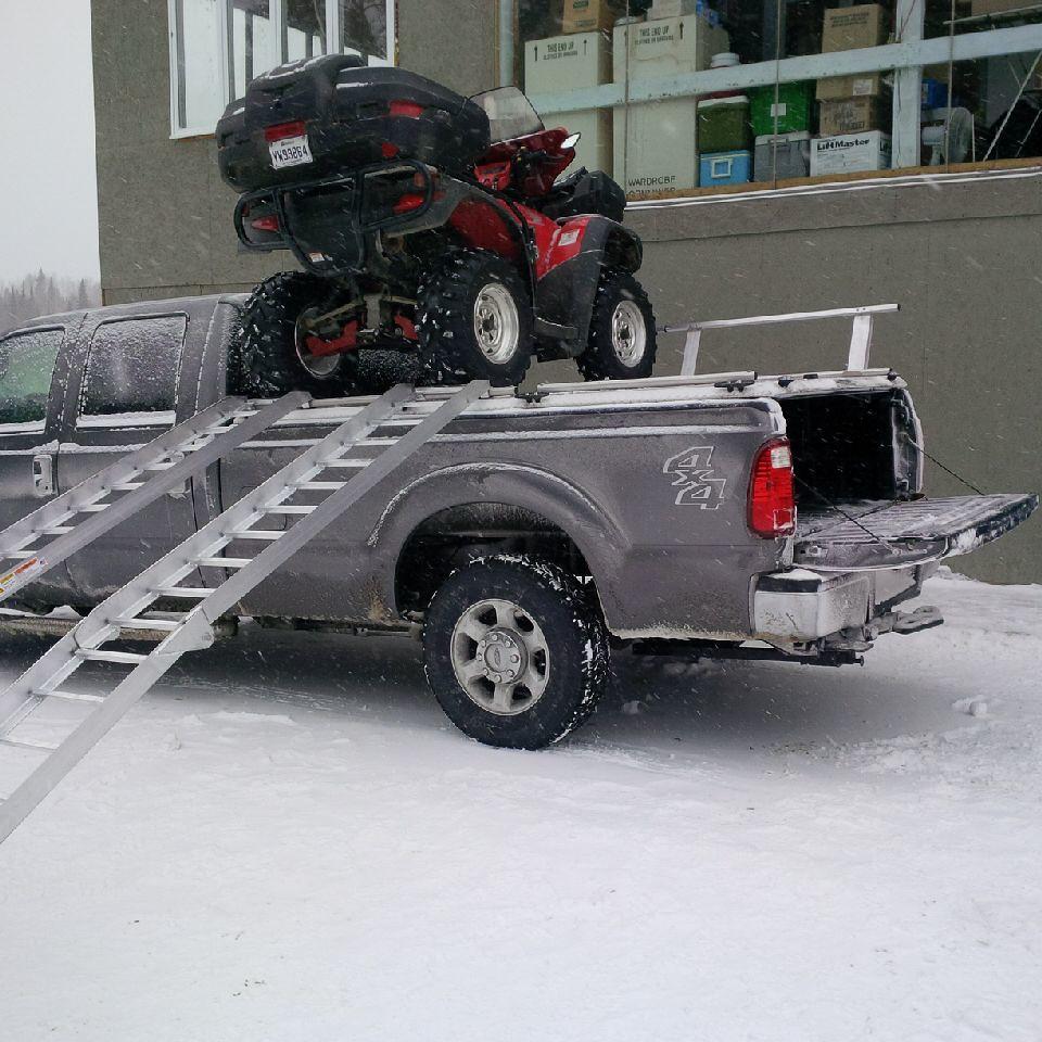 medium resolution of  loading atvs on atv truck rack on ford super duty by diamondback truck covers