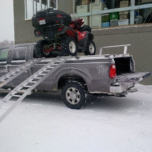 small resolution of  loading atvs on atv truck rack on ford super duty by diamondback truck covers