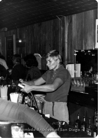 Diablo's Lesbian Bar in San Diego, located on El Cajon Blvd. in North Park. Assistant manager, Char pours drinks for customers.