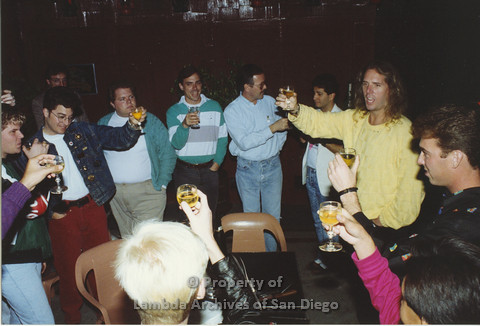 P001.163m.r.t 1st Anniversary 1991: Group of men holding up their glasses