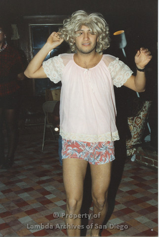 P001.193m.r.t Retreat 1991: man in a blonde wig and pink blouse