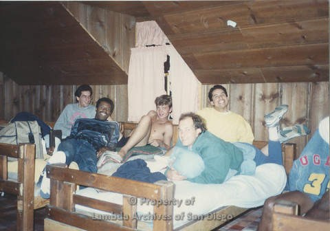 P001.224m.r.t Retreat 1991: 5 men on bunk beds in a cabin