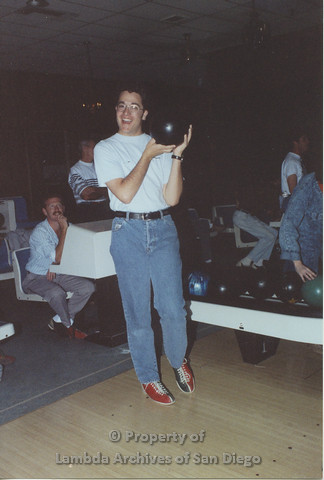 P001.149m.r.t Bowling 1991: Man wearing blue San Diego AIDS Project t-shirt holding a bowling ball