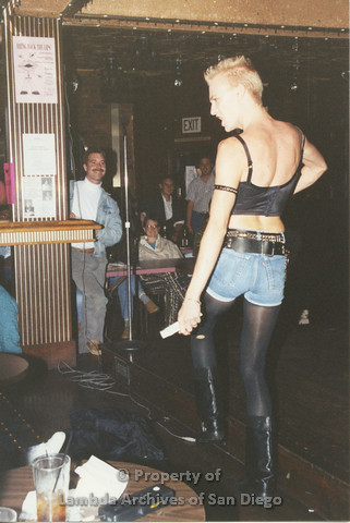P001.252m.r.t Through The Years Fundraiser: drag queen wearing blue jean shorts