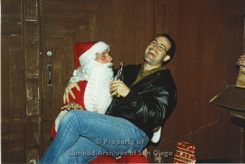 P001.277m.r.t X-mas: man holding a beer and sitting on Santa's lap