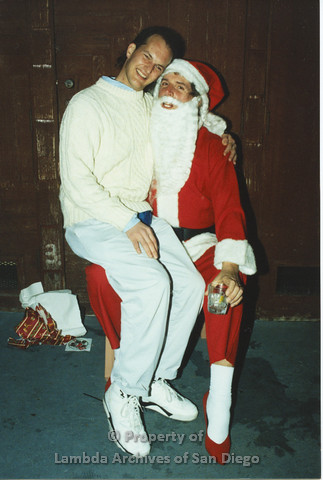 P001.285m.r.t X-mas: man in white sweater sitting on Santa's lap