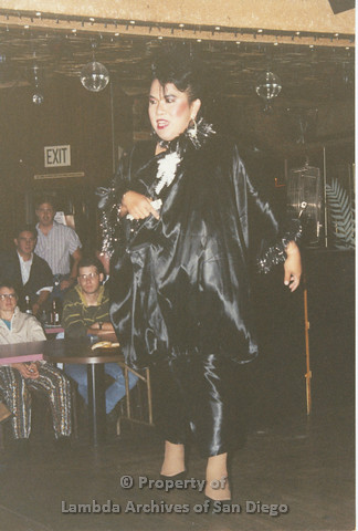 P001.257m.r.t Through The Years Fundraiser: drag queen wearing a black outfit