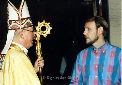 P103.065m.r.t Dignity San Diego: Bishop with golden scepter talking to Bruce Neveu