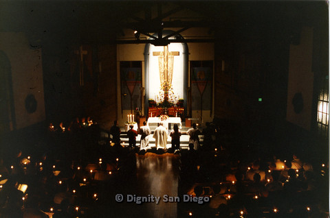 P103.017m.r.t Dignity San Diego, Christmas 1988: Dimly lit shot of whole church congregation with candles