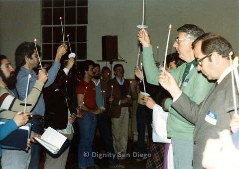 P103.007m.r.t Dignity San Diego: Group of people holding up candles