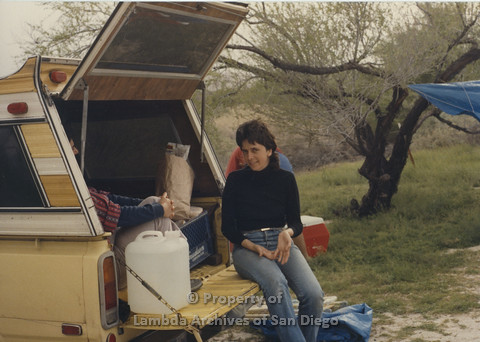 P024.056m.r.t Cathy Moore's 34th Birthday, Halley's Comet Weekend, Anza Borrego Desert 1986: Diane Besemer leaning on the camper of a truck.