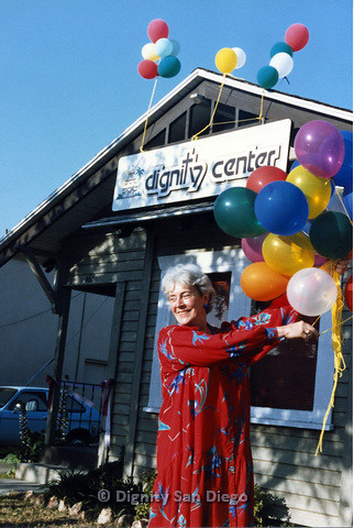 P103.180m.r.t San Diego Dignity Center: Woman with balloons in front of Center