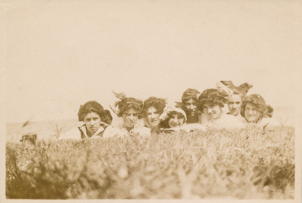 Group of women hiding in the grass