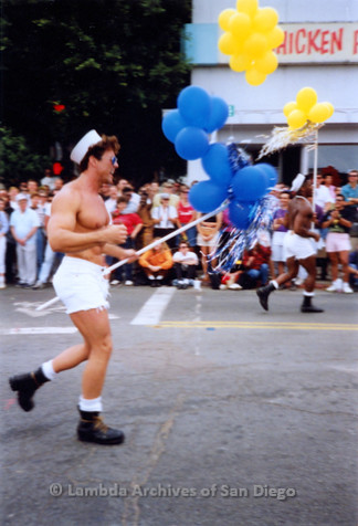 P018.064m.r.t San Diego Pride Parade 1991:  Man in sailor hat and shorts marching in parade