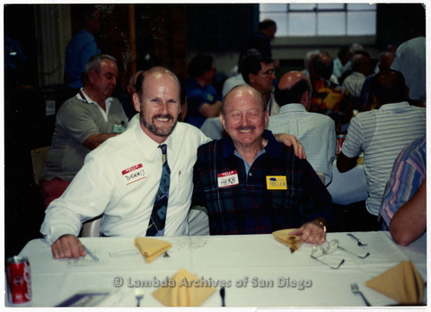 P201.031m.r.t SAGE Event 1994 with Guest Speaker Morris Kight: Dennis Lucarelli and Herb King sitting at table indoors