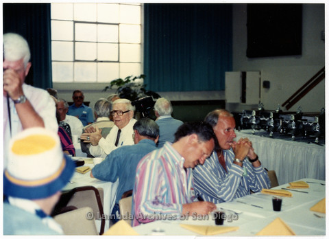 P201.030m.r.t SAGE Event 1992: Morris Kight (in glasses and black tie) and other men sitting at tables indoors