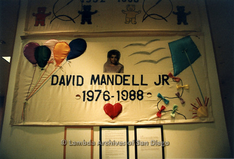 P019.086m.r.t AIDS Quilt at San Diego Golden Hall 1988: Balloon decorated quilt dedicated to David Mandell Jr