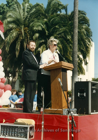 P012.018m.r.t San Diego Walks for Life 1986: Reverand David Farrell speaking at podium with Susan Jester