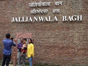 Visitors Pose outside Jallianwala Bagh - Site of 1919 Amritsar Massacre - Amritsar - Punjab - India