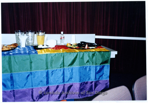 P201.026m.r.t National Coming Out Day at Qualcomm: Food and drinks on a table with rainbow tablecloth