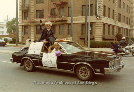 1982 - San Diego Lambda Pride Parade, Miss Gay San Diego - 1982 'Tiffany', riding in a black car along the Pride Parade route.