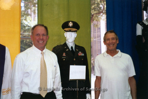 P119.050m.r.t LASD City Hall Exhibit 2010: Frank Nobiletti (right) and another man standing by a military uniform in exhibit