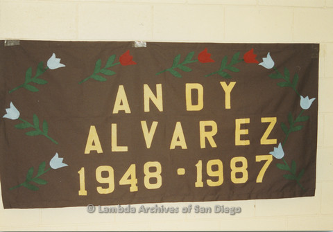 P019.048m.r.t AIDS Quilt at San Diego Golden Hall 1988: Brown quilt decorated with tulips dedicated to Andy Alvarez