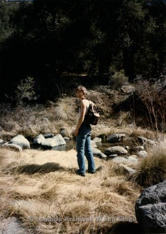 P008.117m.r.t Kitchen Creek 1985: Nikki next to creek