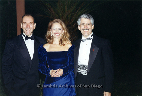 P237.023m.r.t Center Events: Three people at formal event