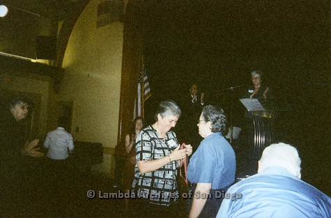 P096.023m.r.t Wall of Honor 2006: Bridget Wilson receiving reward, Christine Kehoe on stage in background, Jeri Dilno applauding (left)