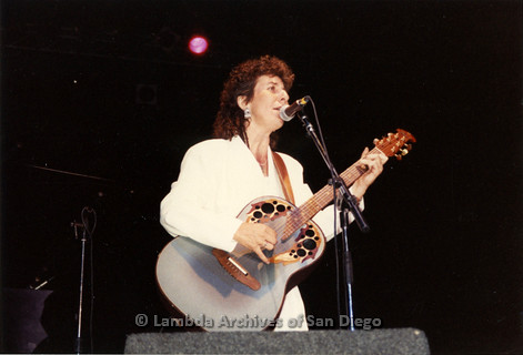 West Coast Women's Music and Comedy Festival, Produced by Robin Tyler in Yosemite, California, Labor Day Weekend 1991. Lesbian Performer, Lucie Blue Tremblay singing and playing her Guitar on the Festival Night Stage.