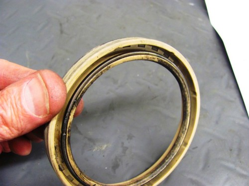 Backside of Original White Rear Main Seal with Spring