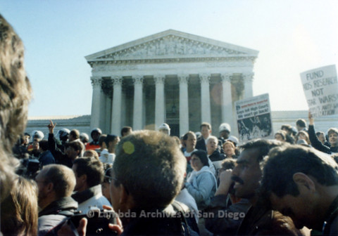 P019.222m.r.t Second March on Washington 1987: Crowd standing beside police guarded barricade in front of U.S. Supreme Court